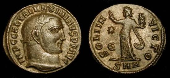 Maximinus II  309-313 AD. AE Follis. Sol holding head of Serapis !