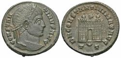 Ancient Coins - Constantine I. A.D. 307/10-337. ' follis. Ticinum, A.D. 326. Near EF, brown patina, a hint of light porosity. Rare.