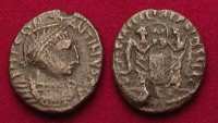 Ancient Coins - CHOICE CELTIC IMITATION OF A CONSTANTINIAN AE, ca. 4th century AD. CONSTANTINVS AVG, Diademed Celtic style head r./Two Victorys beside plaque, blundered legend around. VF. A very i