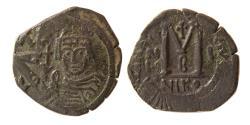 Ancient Coins - BYZANTINE EMPIRE. Heraclius. 610-641. Æ follis. Nicomedia RY 1 or 2. Overstruck on an earlier follis.
