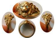 Roaring Lion 18k Gold Ring with blue Diamond eyes.