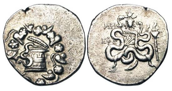 Ancient Coins - IONIA, Ephesos.  AR Cistophoric Tetradrachm   (12.79 gm), yr. 48 (86 BC).  Snake rising from Cista mystica / Bow in case between two serpents, torch to right, head of Isis above.…