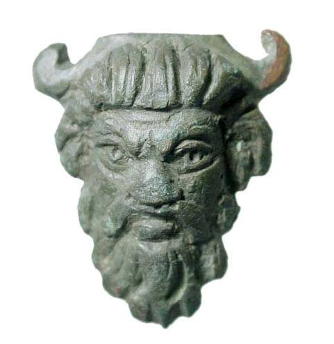 Ancient Coins - Bronze Applique with Head of Satyr.  Roman, II-IV Century AD.  Head of bearded satyr with horns; cast fitting with incised details.  35mm high.