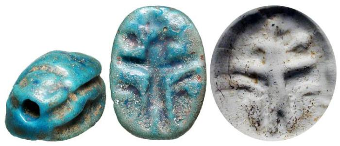 Ancient Coins - Blue Glazed Steatite Scarab.  Egypt, New Kingdom, XV-XI Century BC.   Scarab with stylized beetle back and bezel with standing figure of Horus with cobras at feet, all incuse.  …