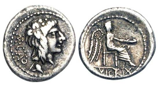 Ancient Coins - ROMAN REPUBLIC. M. Cato, 89 BC.  AR Quinarius (2.03 gm).  Young head of Bacchus wearing ivy-wreath / Victory seated holding patera.  Porcia.7.  S.248.  Cr.343/2. Toned VF.