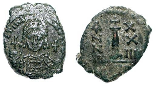Ancient Coins - BYZANTINE EMPIRE. Justinian I, 527-565 AD. AE Dekanummium (4.70 gm) of Antioch year 24. Helmeted bust facing / Large I. S.236.  VF+, dark green patina.