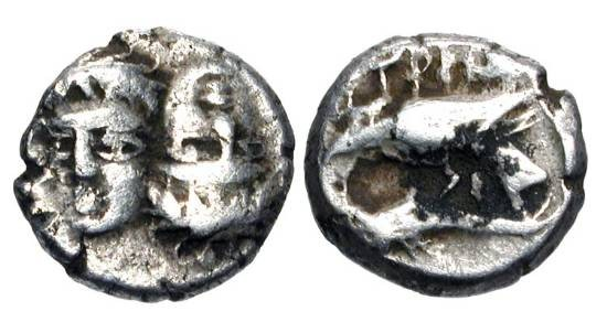 Ancient Coins - THRACE, Istros.  IV Century BC.  AR Trihemiobol (1.35 gm).  Two male heads facing, one inverted / Sea-eagle on dolphin.  SNG.BM.234.  Toned VF.