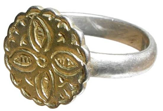Ancient Coins - Silver Gilt Ring.  Byzantine, VIII-XI Century AD.  Silver ring with round bezel engraved with four-pedaled flower within scalloped border; bezel gilt; plain band.  Size 8.  Choice