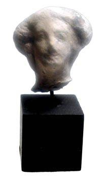 "Ancient Coins - Terracotta Female Head.  Etruscan, ca. 500 BC.  Female head with earring, some black paint remaining on hair and brow.  1.5"" tall.  On custom stand."