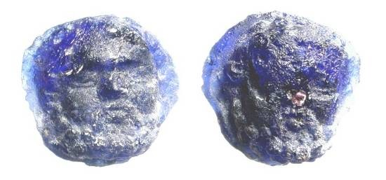 Ancient Coins - Glass Janus Head.  Rome, I-III Century AD.  Blue glass Janus head, mounting hole to bottom as made. 18 x 14 mm.   Glass with some irredicence and weathering.