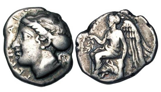 Ancient Coins - BRUTTIUM, Terina.  425-400 BC.  AR Stater (7.65 gm).  Head of nymph Terina / Nike seated on cippus holding wreath.  H-J.57.  Regling.56.  Toned VF.  Rare.
