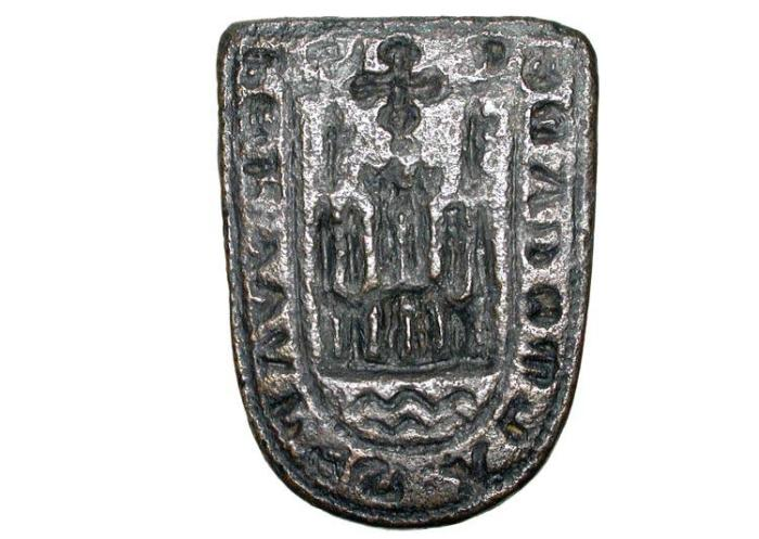 World Coins - Bronze Seal Matrix.  Spain, XIII-XIV Century AD.  Seal of Pedro Juanez Almocader (S PER VVANES ALMOCADER), shield of arms - castle over waves - in shield-shaped seal.