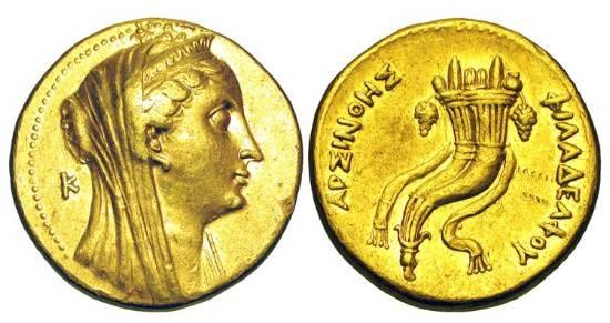 Ancient Coins - PTOLEMAIC KINGDOM.  Arsinöe II under Ptolemy II, 253-246 BC.  Gold Octodrachm (27.77 gm).  Veiled head of Arsinöe II, wearing stephane, K behind / Double cornucopiae.   …