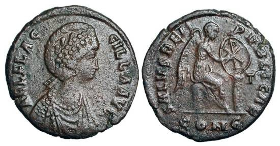 Ancient Coins - AELIA FLACCILLA, wife of Theodosius I, 379-386 AD.  Æ2  of Constantinople 378-383 AD.  Diademed draped bust / Victory seated inscribing Christogram on shield, T to right. VF.  …