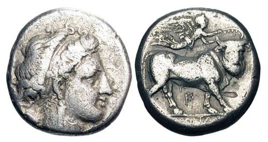 Ancient Coins - CAMPANIA, Neapolis.  ca. 300-275 BC.  AR Nomos (7.14 gm).  Head of nymph / Man-headed bull walking, crowed by flying Nike.  HN.579.  Lightly toned aVF.