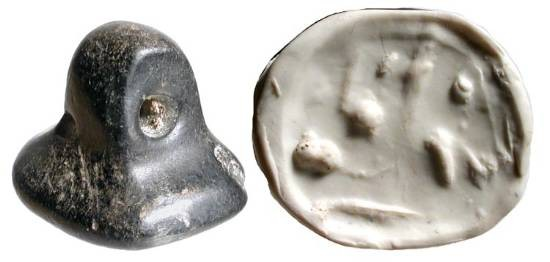 Ancient Coins - Stamp seal of reclining Animal.  Jamdat Nasir, 3100-2900 BC.   Black stone seal with rectangulate bezel and loop top; bezel carved and drilled with reclining pig (?) figure.