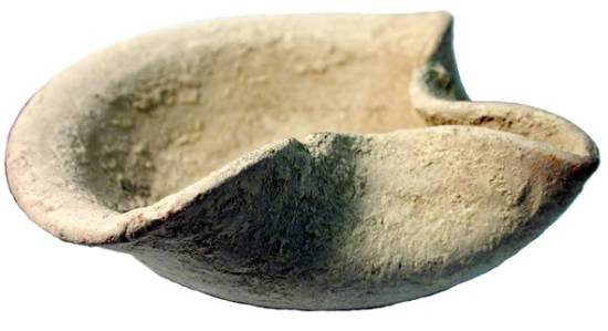 "Ancient Coins - Fired Clay Lamp.  Late Bronze Age Palestine, ca 1500 BC.  Buff fired clay bowl  with pinched nozzle.  5.5"" diameter.  QEDEM.8.314.  Intact with very minor chipping."