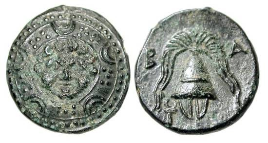 Ancient Coins - KINGDOM of MACEDON.  After 311 BC.  Æ 16 (4.13 gm).  Gorgon head at centre of Macedonian shield / Crested helmet.  SNG.Cop.1125.  aXF, brown black patina.