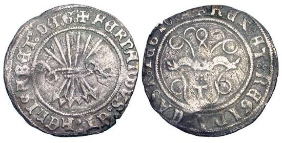 World Coins - SPAIN.  Ferdinand and Isabella, 1469-1504 AD.  AR Half Real (1.52 gm) of Toledo.  Yoke with traces / sheaf of arrows.  C&C.2154.  Toned VF.