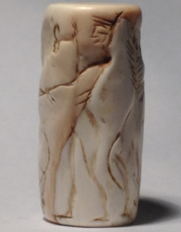 Ancient Coins - A White Shell Cylinder Seal, ca. 3000 BCE