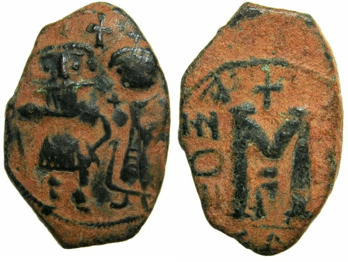 Ancient Coins - ARAB-BYZANTINE.Early Caliphate.AE.Fals.imitating Heraclius ( AD 610-641) or Constans II ( AD 641-668 ).
