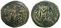 Ancient Coins - BYZANTINE EMPIRE.Heraclius AD 610-641.AE.Follis, struck AD 615/616.Mint of NIKOMEDIA. ~~~Overstrike on Follis of Justin II, Kyzicus mint.