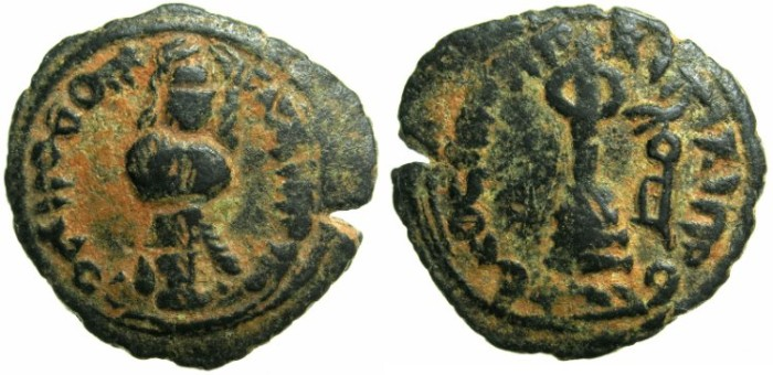 Ancient Coins - UMAYYAD CALIPHS.Abd al-Malik 65-86H ( AD 685-705).AE.Fals.Mint of Hims ( Helipolis).~~~Standing caliph.