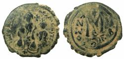 Ancient Coins - BYZANTINE EMPIRE.Heraclius AD 610-641.AE.Follis. Overstrike on Justin II ( AD 565-578 )