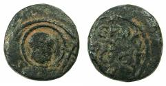 World Coins - CRUSADER STATES.Principality of ANTIOCH.Tancred AD 1104-1112.AE.Follis.1st type, large flan. Overstriike on a Roman colonial coin?
