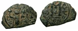 Ancient Coins - PSEUDO BYZANTINE.7th cent AD.AE.Fals, after Constans II AD ( AD 641-669 ).***Imperial figure holding raised cross in right hand *** RARE type.