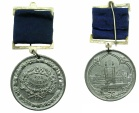 World Coins - EATON COLLEGE.School attendence medal circa 1870's.Struck in white metal.