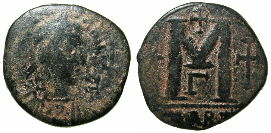Ancient Coins - BYZANTINE EMPIRE.Justinian I AD 527-565.AE.Follis. Mint of CARTHAGE. ~~~Emperor with Chi-Rho monogram on chest
