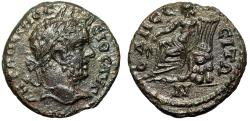 "Ancient Coins - Caracalla AE19 of Odessos in Moesia ""Apollo Seated on Rocks, Lyre"" Scarce aEF"