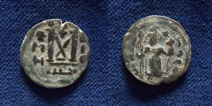 Ancient Coins - ISLAMIC, Umayyad Caliphate. temp. Mu'awiya I ibn Abi Sufyan. AH 41-60 / AD 661-680. Æ Fals.