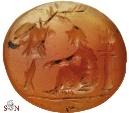 Ancient Coins - Intaglio on carnelian - female figure seated beneath trophy