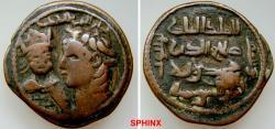 "World Coins - 564RK9X) Artuqids of Mardin. Husam al-Din Yuluq Arslan. 1184-1201 AD. AE Dirhem (32.5 mm, 13.87 gm). Roman style (""Nero"") head left, at left, smaller Byzantine bust facing / Four l"