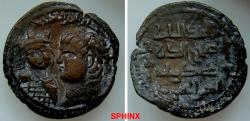"World Coins - 563RK9X) Artuqids of Mardin. Husam al-Din Yuluq Arslan. 1184-1201 AD. AE Dirhem (31 mm, 10.94 gm). Roman style (""Nero"") head left, at left, smaller Byzantine bust facing / Four lin"