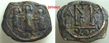 World Coins - 62FF8) Arab-Byzantine, Pseudo-Byzantine coinage, Type B, without mint, circa 650s-680s, AE fals, large module, 23 X 20 mm, 4.05 grms, Obv. three standing figures holding long cross