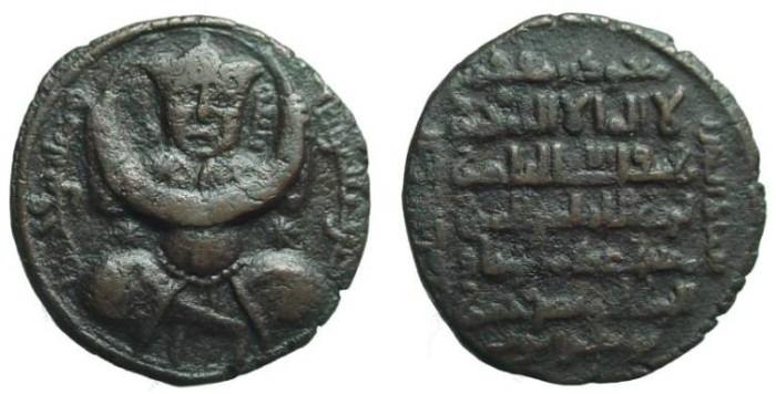 Ancient Coins - 1408EC) Zengid Atabegs of Mosul. Izz al-Din Masud I. AH 576-589, 1180-1193 AD. Æ Dirhem (27 mm, 13.39 gm). Seated Turk facing, holding crescent with both hands / Six line legend. S