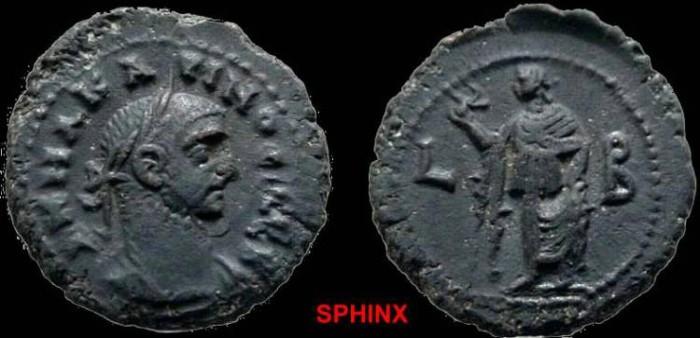 Ancient Coins - 834EE8) ROMAN, EGYPT, ALEXANDRIA, CARINUS, 282-285 AD, AE TETRADRACHM, ELPIS REV RAISING SKIRT AND HOLDING FLOWER. i.f. YEAR L B = YEAR 2, CURTIS 1917, BMC 2454 IN VF COND.