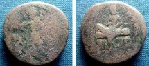 Ancient Coins - 133BLS) Kushan dynasty, Huvishka, 2nd cent AD, AE25, 15.6 grms, King lounging on low bench resting left elbow on cushion, and right foot on bench, Rev. Siva nimbate, standing left,