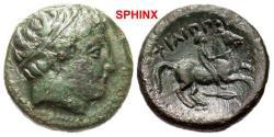 Ancient Coins - 239FM5) Macedonian Kingdom. Philip II. 359-336 B.C. Æ unit (17.1 mm, 5.50 g, 8 h). Uncertain Macedonian mint, 306-297 B.C. Head of Apollo right, wearing tainia / ΦIΛIΠΠOY, Youth on