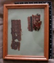 Ancient Coins - 29COP) 2 Framed Coptic textile fragments (2 different) one with abstract human figure and the other displaying crosses;