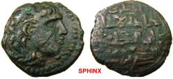 World Coins - 812EG8) ARTUQIDS OF MARDIN, NAJM AL-DIN ALPI, 547-572 AH/ 1152-1176 AD; AE DIRHAM 13.08 GRMS, NAJM AL-DIN ON NECK OF SELEUCID STYLE BUST RIGHT; THE COUTERMARK INCORPORATED IN THE O