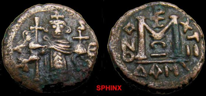 Ancient Coins - 293HG1) ARAB-BYZANTINE. Tiberias (?) mint. Circa 680-690 AD. Æ Fals (18 mm, 3.12 gm, 6h). Byzantine style standing emperor, VF RARE