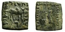 Ancient Coins - 541FC) KINGS of BAKTRIA. Philoxenos. Circa 100-95 BC. Æ Unit (8.52 g, 12h). Bilingual series. Tyche standing left, holding cornucopiae; monogram to lower left / Zebu bull standing