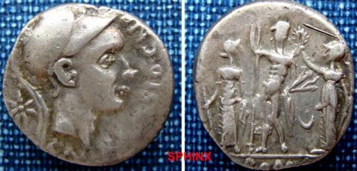 Ancient Coins - 50HM0) Cn. Blasio Cn.f. 112-111 BC. AR Denarius (20mm, 3.87 gm). Helmeted head of Scipio Africanus right; star behind / Jupiter standing between Juno and Minerva; crescent between