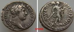 Ancient Coins - 82GC9X) Hadrian. AD 117-138. AR Denarius (18 mm, 3.29 g). Rome mint. Struck circa AD 134-138. Laureate bust right, slight drapery / Romulus, wearing military attire advancing right