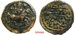 World Coins - 317ER0Z) Seljuq of Rum. Kaykhusraw I b. Qilij Arslan, Ghiyath al-Din. 1st reign, 588-595/1192-1198. AE fals (22.5 mm, 3.52 grms). Kaykhusraw I holding mace, charging right on horse