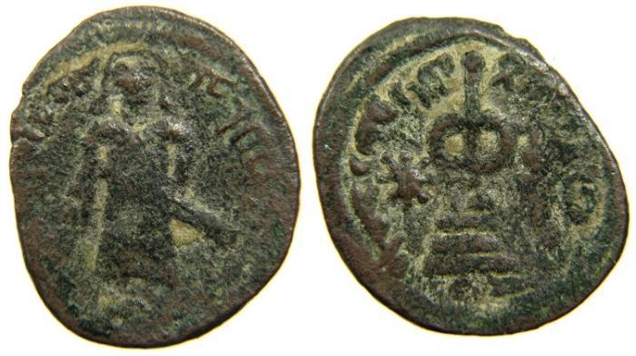 World Coins - ISLAMIC, Arab-Byzantine Standing Caliph Series, 'Abd al-Malik b. Marwan, AH 65-86/ AD 685-705, AE Fals, 'Amman.